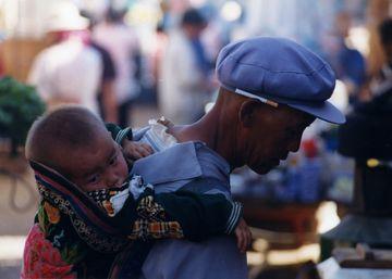 Číňan s dítětem